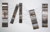 """Alignment..? (2013) Charcoal, Rust, Acrylic and Carbon Fibre on Aluminum, 40"""" x 66"""""""